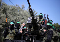 Palestinian Hamas militants attend a military drill in preparation to any upcoming confrontation wit