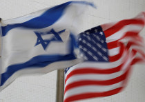 The American and the Israeli national flags can be seen outside the U.S Embassy in Tel Aviv, Israel