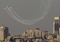 AN ISRAEL AIR FORCE aerobatic team flies in formation during an aerial show for Independence Day.