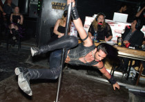 A man participates in pole dancing at Israel's only S&M club, the Dungeon
