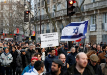 People participate in a unity rally after the murder of French Holocaust survivor Mireille Knoll in