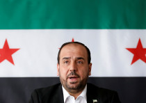 Nasr al-Hariri, Head of the Syrian Negotiation Commission, speaks at a news conference in Brussels