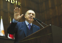 TURKISH PRESIDENT Tayyip Erdogan addresses members of the parliament from his AK Party in Ankara.