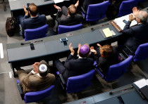 Members of the German parliament wearing kippas attend a session of the Bundestag in Berlin