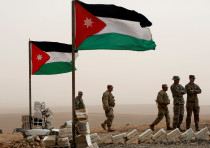 US soldiers stand next to Jordanian flags as they take part in Exercise Eager Lion at one of the Jor