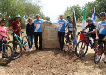 The Israeli Cycling Academy team, granddaughter Gioia Bartali, Italian Ambassador Gianluigi Benedett