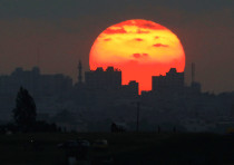 The sun sets over the Gaza Strip, as seen from the Israeli side of the border May 15, 2018