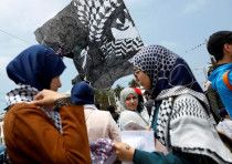 Pro-Palestinian protesters participate in a protest organized by Al Adl wal Ihsane.