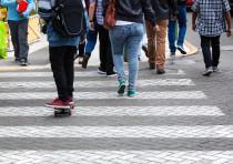 Pedestrians cross at a crosswalk
