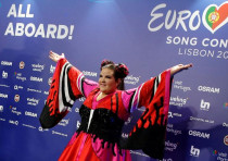 Israel's Netta arrives for the news conference after winning the Grand Final of Eurovision.