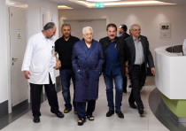 Palestinian President Mahmoud Abbas walks inside the hospital in Ramallah
