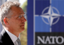 NATO Secretary-General Jens Stoltenberg enters the new NATO headquarters building in Brussels