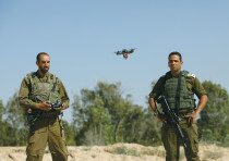 A DRONE FLOWN by IDF soldiers trying to intercept Palestinian kites and balloons loaded with flammab