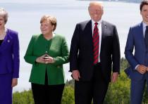 Britain's Prime Minister Theresa May, Germany's Chancellor Angela Merkel, US President Donald Trump
