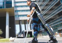 A MAN walks using ReWalk, an electronic exoskeleton, at a development center in Haifa