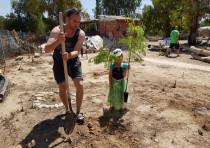 Tree planting event in Kibbutz Nahal Oz on the Gaza Border