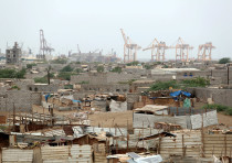 Hodeidah port's cranes are pictured from a nearby shantytown in Hodeidah, Yemen