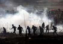 File photo of Palestinians protesting on the Gaza side of the border between Israel and Gaza