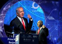 Israeli Prime Minister Benjamin Netanyahu gestures as he speaks during the Cyber Week conference at