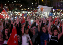 AK Party supporters celebrate in front of the AKP headquarters in Ankara, Turkey June 24, 2018
