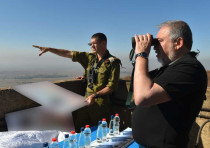Defense Minister Avigdor Liberman looks at Syria from the Golan Heights