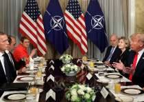 US President Donald Trump holds a breakfast meeting with NATO Secretary General Jens Stoltenberg (L)