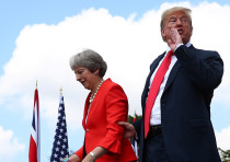 Britain's Prime Minister Theresa May and US President Donald Trump walk away after holding a joint