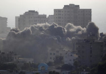 Smoke rises following an Israeli strike on a building in Gaza City July 14, 2018