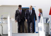Russia's Ambassador to Finland Pavel Kuznetsov (L) welcomes Russian President Vladimir Putin