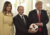 RUSSIAN PRESIDENT Vladimir Putin, US President Donald Trump and first lady Melania Trump pose with a