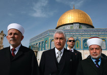 MUFTI OF JERUSALEM Mohammed Hussein (right) walks in front of the Dome of the Rock in 2007