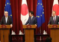 Juncker, left, Abe, center and Tusk, right