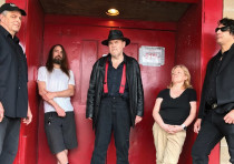 DAVID THOMAS (center) with his band mates in Pere Ubu
