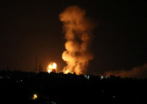 An explosion is seen following an Israeli air strike in the southern Gaza Strip July 20, 2018