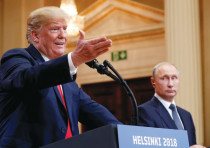US PRESIDENT Donald Trump gestures during a joint news conference with Russia's President Vladimir P