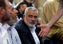 Hamas Chief Ismail Haniyeh looks on as he attends the funeral of Palestinian Hamas militants