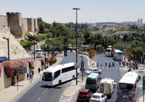 A view of Jerusalem's Old City walls near Jaffa Gate, with a tour bus in the center, August 9 2018