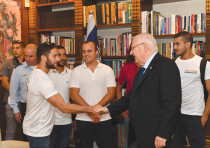 PRESIDENT REUVEN Rivlin with soldiers who served with soldiers whose bodies are being held by Hamas