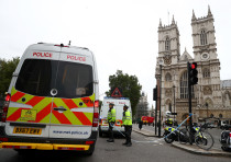 Police officers stand at a cordon after a car crashed outside the Houses of Parliament in Westminste