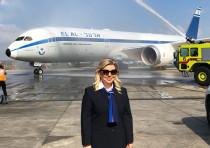 Sara Netanyahu poses in front of a 'retro' El Al plane, August 14, 2018