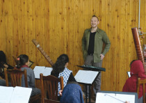 DAN BLACKWELL with members of the Zohra orchestra in Afghanistan. 'I'm coming to [Israel] from a hum