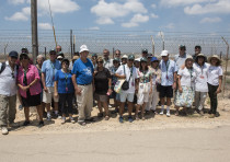 French delegation group photo at the Kibbutz Nahal Oz security fence
