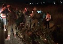Soldiers gather around car crash site in Havat Gilad, 2018