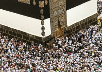 Muslim pilgrims circle the Kaaba and pray at the Grand mosque ahead of annual Hajj pilgrimage in  Me