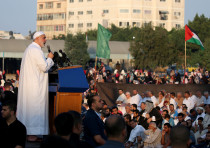 Palestinian Hamas Chief Ismail Haniyeh gives a speech after prayers on the first day of Eid al-Adha