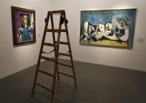 A ladder stands in front of two paintings by Pablo Picasso at the Israel Museum in Jerusalem; Picass