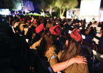 SOLDIERS SING slihot on the lawn outside the synagogue at the President's Residence.