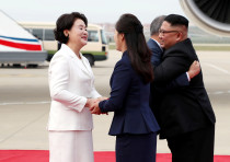 South Korean President Moon Jae-in is greeted by North Korean leader Kim Jong Un during an official