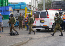 IDF and Magen David Adom at the sceneof the terror shooting in the Barkan industrial Zone