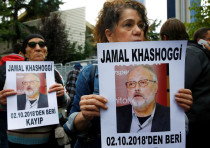 HUMAN RIGHTS activists hold pictures of Saudi journalist Jamal Khashoggi during a protest outside th